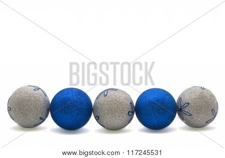 Row Of Blue And Silver Christmas Balls Isolated On White