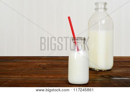 fresh glass of milk with bottle
