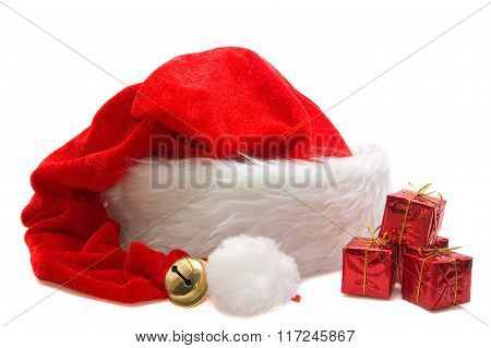 Red Santa Claus Hat With Small Presents Isolated On White