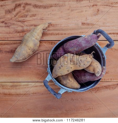 Harvested Organic Sweet Potatoes In The Old Pot On Rustic Wood Table.