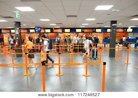 ROME, ITALY - AUGUST 16, 2015: easyJet check-in area. EasyJet is a British low-cost airline carrier based at London Luton Airport. It is the largest airline of the United Kingdom