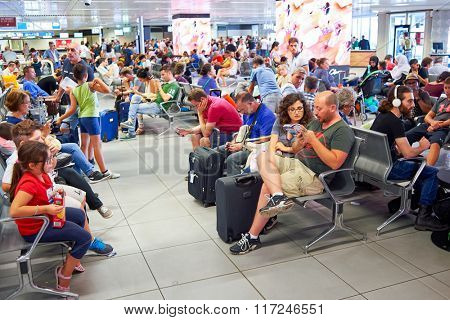 ROME, ITALY - AUGUST 16, 2015: passengers in Fiumicino Airport. Fiumicino - Leonardo da Vinci International Airport is a major international airport in Rome, Italy