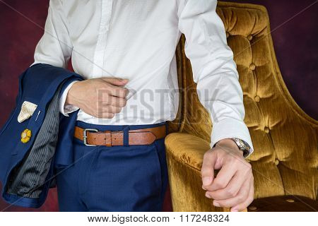 Man Carris Jacket Suit Standing Beside Sofa