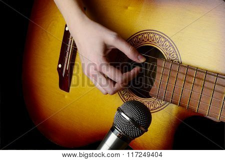 Girl Playing Guitar For Recording