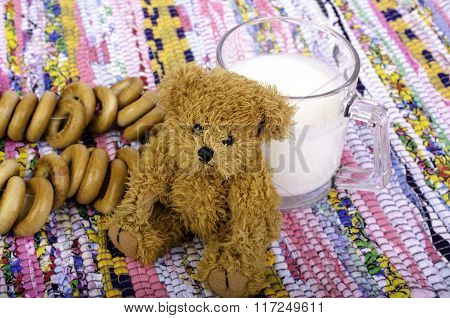 Cup Of Milk, Bagels, And  Teddy Bear.