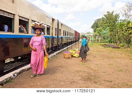 BAGO, MYANMAR - November 16, 2015: Hawkers selling goodies. Trains in lower Myanmar are little communities of their own with hawkers selling everything imaginable.