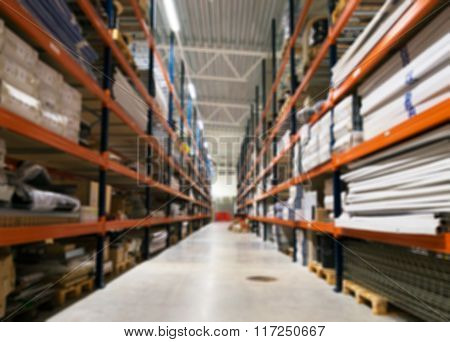 Blurred Warehouse Storage Racks. Suitable For Background.