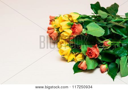 Yellow And Red Roses On A Light Wooden Background. Women' S Day, Valentines Day, Mothers Day