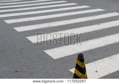 Black and white crosswalk.