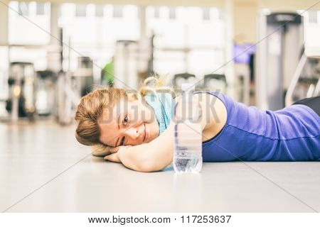 Exhausted Woman In A Gym