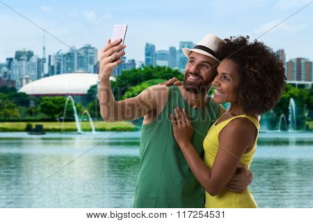 Couple taking a selfie photo in Sao Paulo, Brazil
