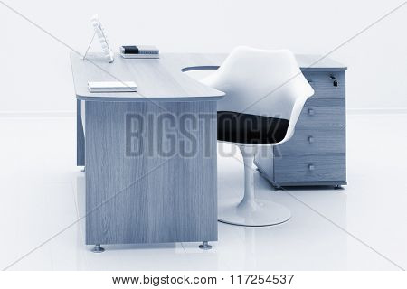 table and white armchair on a white wall