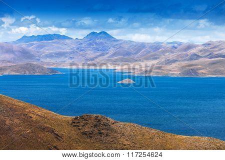 a small island in the mountain lake