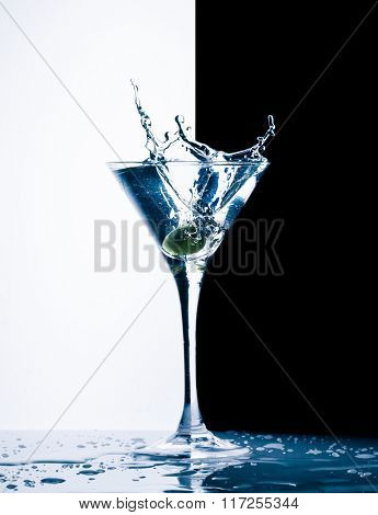 classic contemporary cocktail with splashes on black and white background