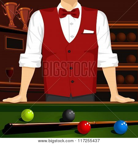 man leaning on a pool table with cue stick and colorful billiard balls