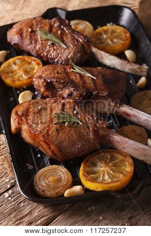 Beef Steak With Spices On The Grill Pan Close-up On The Table. Vertical