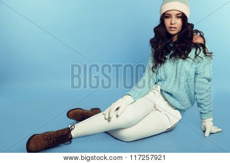 beautiful sexy girl with dark hair wears warm cozy winter clothes