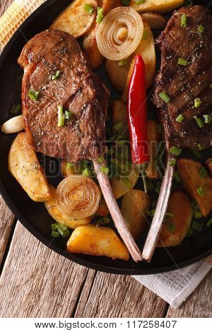 Grilled Beef Steak With Fried Potatoes On A Plate Close-up. Vertical Top View