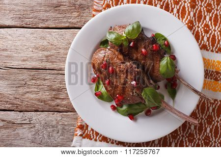 Grilled Beef Steak With Pomegranate On A Plate. Horizontal Top View