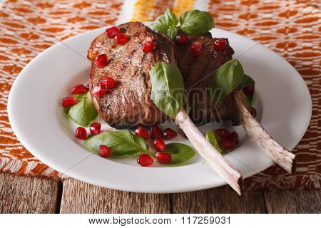 Grilled Beef Steak With Pomegranate Closeup On A Plate. Horizontal
