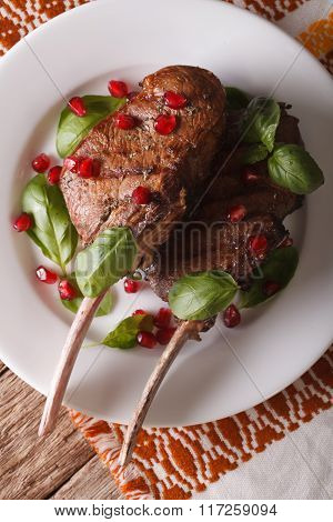 Beef Steak With Pomegranate Seeds And Basil Close-up. Vertical Top View