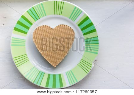 Heart on an old ceramic saucer