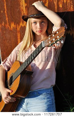Teenage Girl Holding Guitar