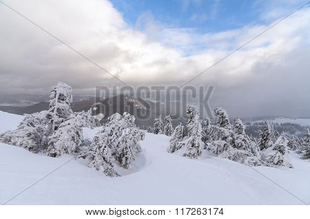 Bad Weather In The Mountains. Winter Landscape. Cloudy Evening With Storm Clouds. Carpathians, Ukrai