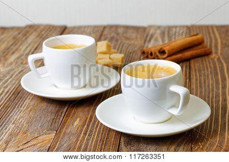 Two Cup Of Hot Esspresso, Cinnamon And Sugar Cane