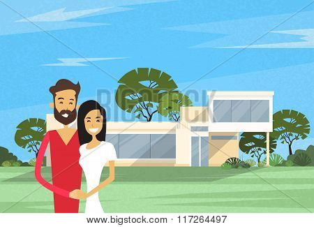 Couple Embracing In Front Of New House Modern Villa