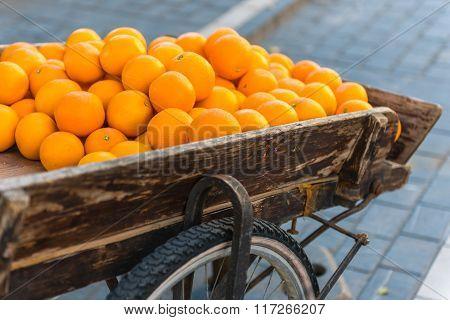 Fresh Oranges On Vintage Wooden Cart