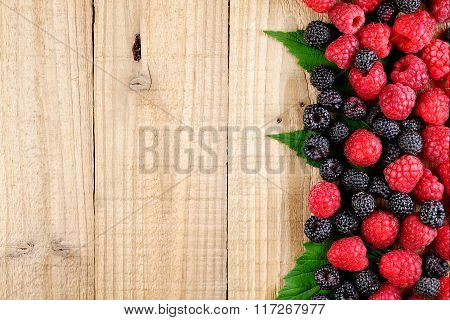 Raspberries On Wooden Background Top View