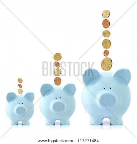Growing piggy banks with Euro coins falling.  Investment growth concept.