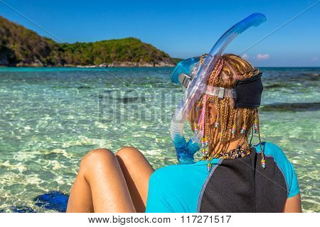 Snorkeler relaxing on tropical beach