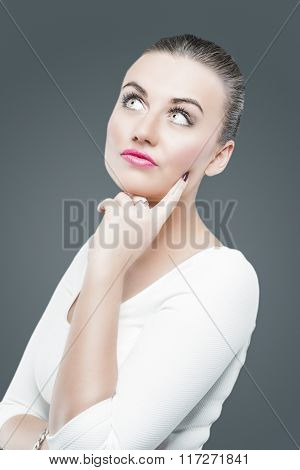 Emotions And Feelings Concept. Brunette Caucasian Female In White Dress Dreaming And Looking Upwards