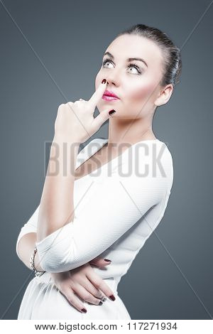 Feelings Concept. Brunette Caucasian Female In White Dress Dreaming And Looking Upwards. Touching No