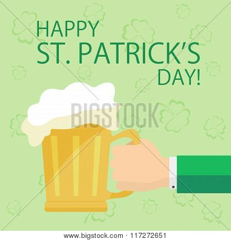 Hand With Beer On Patricks Day Background