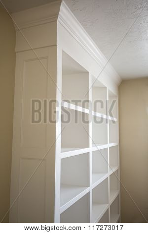 Elegant newly-built white book shelves indoor photo