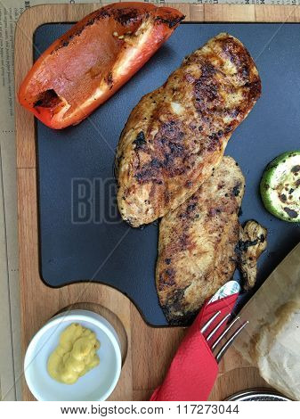 fresh grilled  chicken steak food with vegetables, top pov view