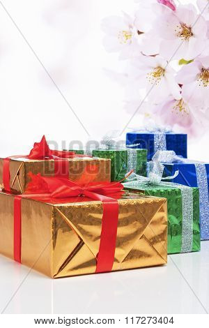 Presents And Celebration Concepts. Many Colorful Wrapped Up Gift Boxes Standing In Line Together. Ag