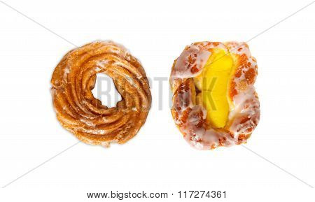 Sweet buns: one with hole, other one with yellow vanilla pudding and glaze isolated on white background