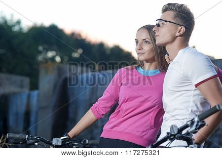 Sportive Caucasian Couple With Mtb Bicycles Dating Outdoors. Together With Mtb Bikes.
