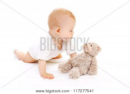 Cute Baby Playing With Teddy Bear On White Background