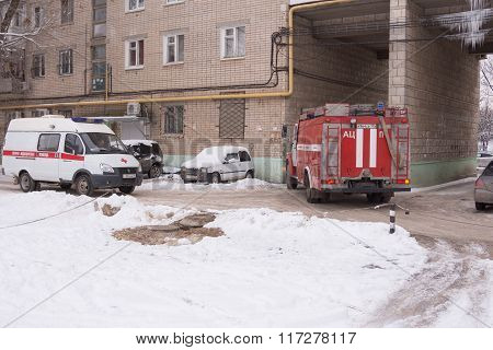 Fire Service Car Leaves From The Yard Of A Multistory Building, Which Is Also An Ambulance