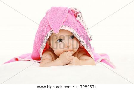 Portrait Of Cute Baby Under Towel Lying On Bed