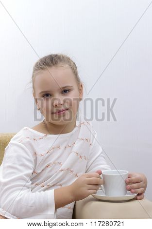 Pretty Little Girl Drinking Hot Chocolate And Relaxing