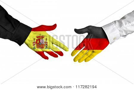 Spain and Germany leaders shaking hands on a deal agreement