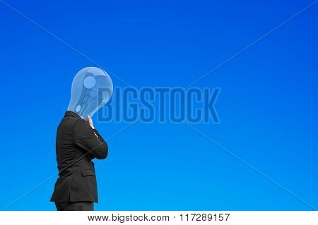 Businessman With Lamp Head Chin In Hand, Thinking