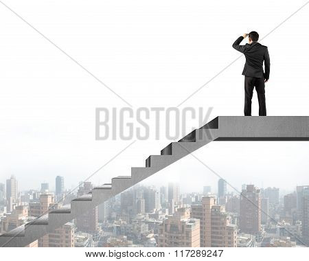 Rear View Businessman Gazing At City On Concrete Stairs Top