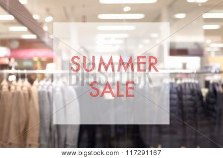 Promotion poster on glass window at fashion clothes store